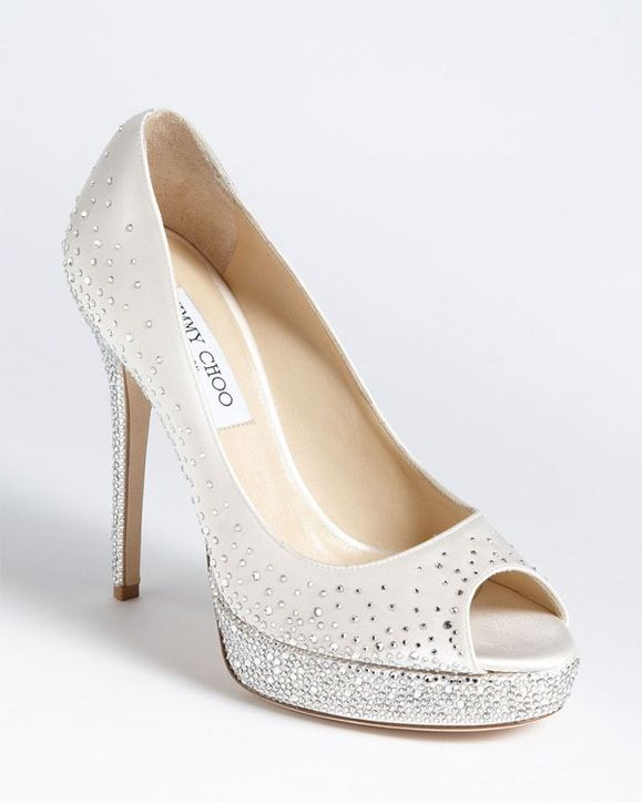 Whether you walk the aisle in classic white pumps, boldly hued stilettos, or glitter-dusted booties, our lineup of the season's must-wear wedding shoes promises the perfect pair.