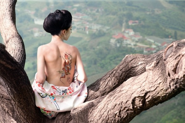 Woman with snake tattoo
