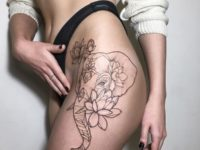elephant and lotuses tattoo on the thigh
