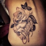 Beautiful Black Rose Tattoo with Leaves