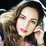 Kelly Brook takes a quick selfie