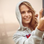Girl taking a Hoodie Selfie