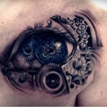 Beautiful Mechanical Black Eye Tattoo on Left Chest
