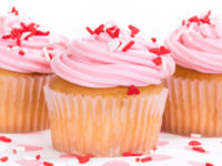 Pink Valentines Day cupcakes with sprinkles, shallow depth
